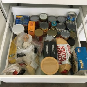 The bottom drawer is for things that really don't fit elsewhere — canned beans & coconut milk, baking products, protein powder, nut bars, blue corn chips, nut crackers.